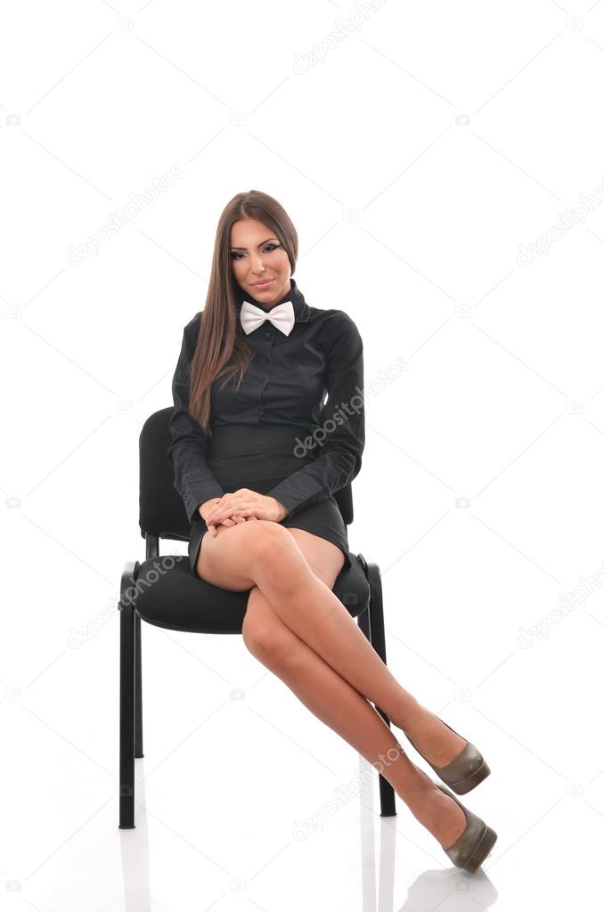 Young Student Sitting On A Chair With Her Legs Crossed