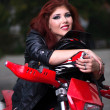 Portrait of an attractive redhead biker chick — Stock Photo