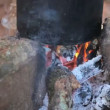 Cooking over fire tight shot — Stok video
