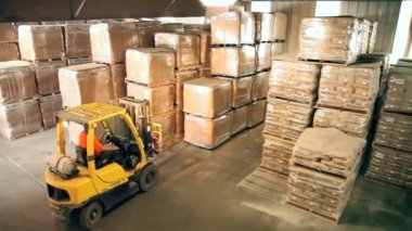 Forklift in warehouse — Stock Video