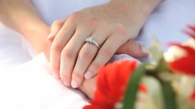 Couple grasps hands with wedding boquet — Stock Video