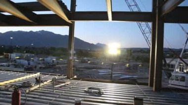 Drifting shot of construction site at sunrise. — Stock Video