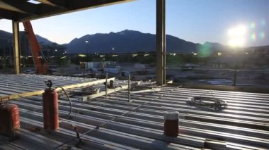 Construction site at sunrise. — Stock Video