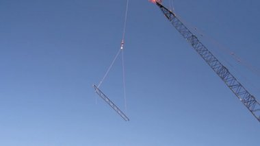 Tight shot of steel beam being lifted. — Stock Video
