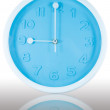 Stock Photo: Nine o'clock on dial clock