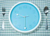 Clock with spoon and fork — Foto Stock