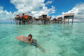 Boy swimming in front of his house in Semporna,Sabah Malaysia — Stock Photo