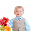 Little boy with flowers — 图库照片