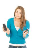 Mujer con teléfonos — Foto de Stock