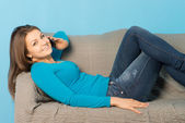 Woman lying with phone — Stock Photo