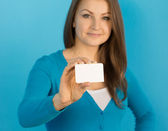 Woman shows card in hand — Stock Photo