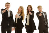 Group of four businesspersons shows thumb up — Stock Photo