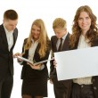 group of business people holding ein werbebanner, isoliert auf weiss — Stockfoto
