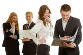 Group of business people with laptop and folder — Stock Photo