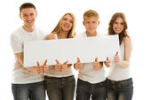 Group beautiful of happy young people with ad — Stock Photo