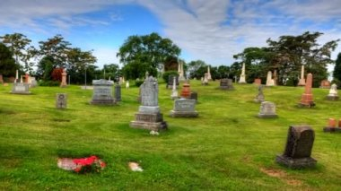 Timelapse view in a cemetary with blue skies — Stock Video