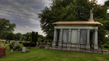 Timelapse view in a cemetary with mausoleum in foreground — Stock Video