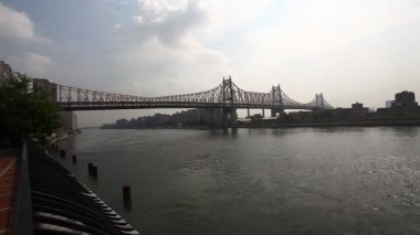 The Queensboro Bridge in Manhattan with a helicopter in the distance — Stock Video
