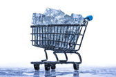 Ice cubes in a supermarket trolley — Stock Photo