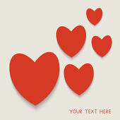 Card decorated with red paper hearts. — Stockvector