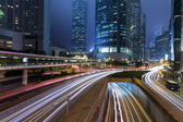 Hong Kong Business District at Night with Light Track — Stock Photo
