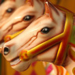 Abstract of three brightly colored carousel horses — Stock Photo #50283297