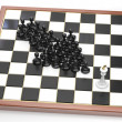 Arrow made of black pawns points to the white king — Stock Photo #42666025