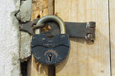 Door in the past. Old pad lock. — Stock Photo