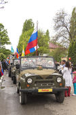 Road convoy on parade in honor of the Victory in the Second Worl — Stock Photo