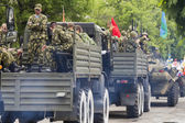 Column of military equipment on parade in honor of the 69th anni — Stockfoto