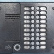 Old gray intercom on a blue metal door — Stock Photo #46763295