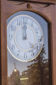 Wooden clock in retro style with a reflection — Foto Stock