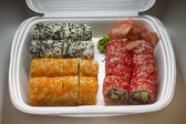 Set of sushi rolls in plastic box — 图库照片