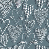 Vector seamless pattern with decorative hearts — Stock Vector