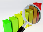 Business graph and magnifying glass — Stock Photo