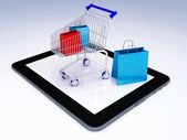 Shopping Cart over Tablet PC. E-commerce Concept. — Stock Photo