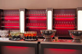 Bar with red backlight — Stock Photo