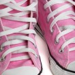 Old pink coloured basketball shoes — Stock Photo #41682833