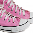 Old pink coloured basketball shoes — Stock Photo