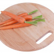 Carrots on a chopping board — Stock Photo #42681403