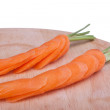 Carrots on a chopping board — Stock Photo #42681419