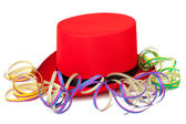 Red top hat with streamers — Stock Photo