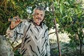 Senior farmer holding a fork — Stock Photo