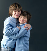 Two young brothers hugging and smiling — Stock Photo