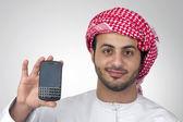 Arab ember gazdaság telefon — Foto Stock