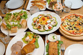 Table with various food served — Stock Photo