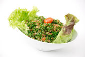 Plate of traditional Arabic salad tabbouleh — Stock Photo