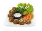Falafel dish with veggies — Stock Photo