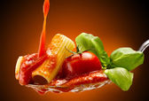 Basil pasta and tomato sauce — Stock Photo