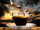 Coffee 'hot served in a small cup at sunset — Stock Photo
